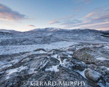 A photograph of a snow covered Lochnagar