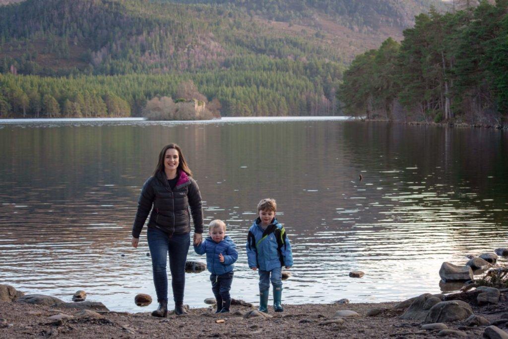 Mother and sons enjoying Loch an Eilein