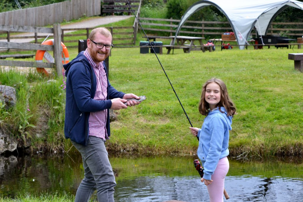 father and daughter fishing at Rothiemurchus