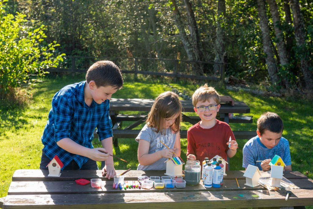 Children paiting mini bird houses at Rothiemurchus Fishery